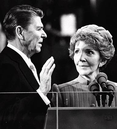 Nancy Reagan watches as her husband, Ronald Reagan, takes the oath of office