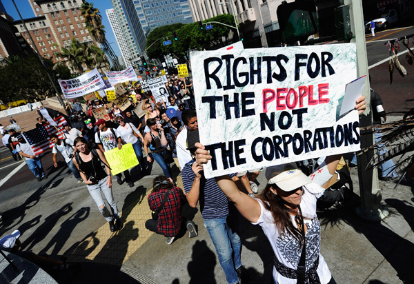 Protestors march to L.A. City Hall in solidarity with the Occupy Wall Street movement.
