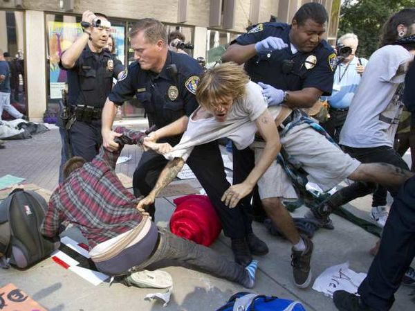Police tussle with Occupy San Diego protesters.