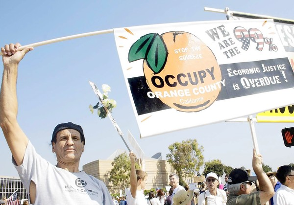 Alex Sircello of Orange County with other protesters outside Irvine City Hall. (Oct. 15, 2011)