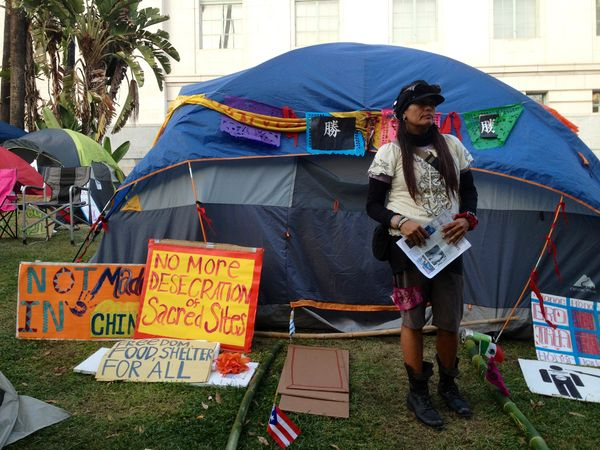 Regina Quetzal Quiñones outside one of the Indigenous Peoples' Committee tents in downtown Los Angeles.