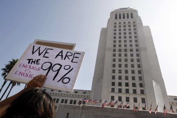 A few thousand people take part in a march that started at Pershing Square and ended at Los Angeles City Hall. (Oct. 15, 2011)