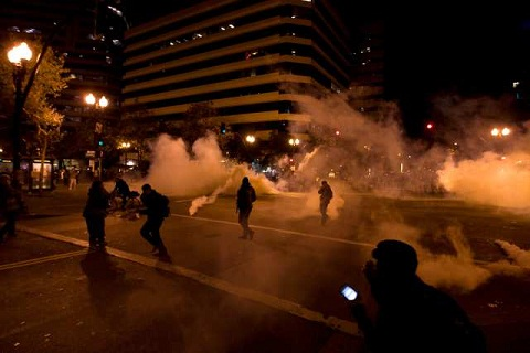 Police use tear gas to disperse Occupy Oakland protesters.