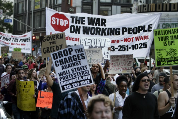 Occupy L.A. protesters march along Broadway in downtown Los Angeles.