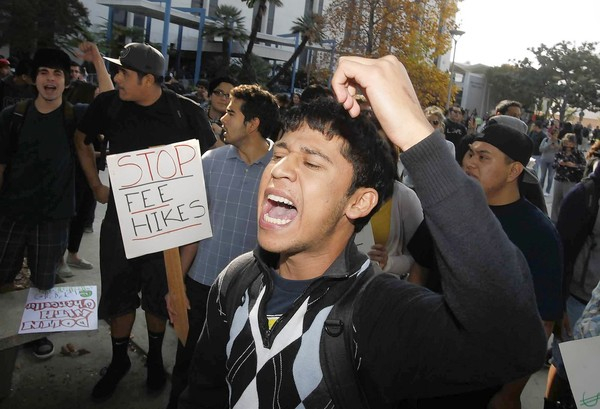 Cal State Fullerton sophomore Claudio Soria leads fellow students in a protest of tuition hikes. (Nov. 15, 2011)