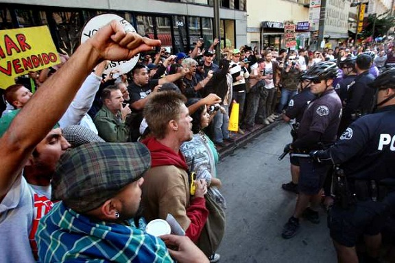 Members of the Occupy Los Angeles movement face off with police officers during a march through downtown L.A. (Dec. 3, 2011)