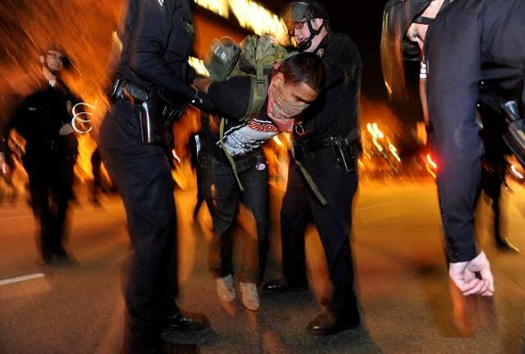 LAPD officers arrest an Occupy L.A. protester. (Nov. 30, 2011)