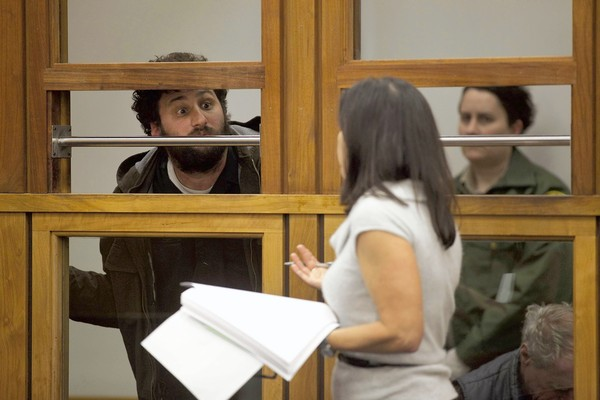 John Doe II, who was arrested during the Occupy L.A. raid, attempts to get a last word in with deputy public defender Carrie Miner as she defends him in Los Angeles' Central Arraignment Court. He was released with no charges.