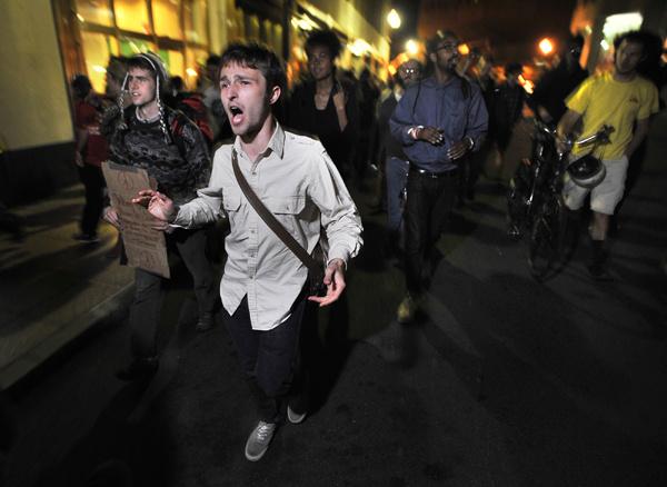 Demonstrators with Occupy Boston march toward the police station, where fellow demonstrators were taken after arrests. (Oct. 11, 2011)