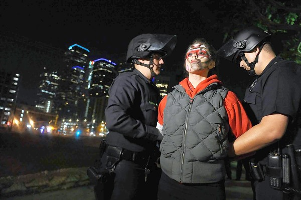 Los Angeles police officers arrest an Occupy L.A. protester near the City Hall encampment. (Nov. 30, 2011)