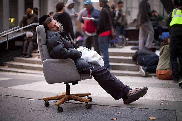 An Occupy Wall Street protester falls asleep in an armchair.