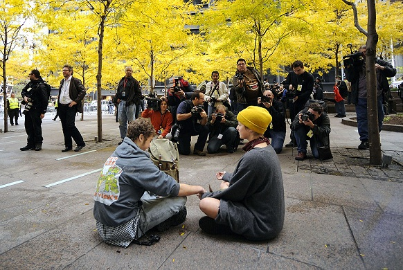 People meditate in Zuccotti Park after police remove hundreds of Occupy Wall Street demonstrators.