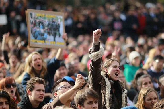 A student pumps her fist during a demonstration at UC Davis. (Nov. 21, 2011)