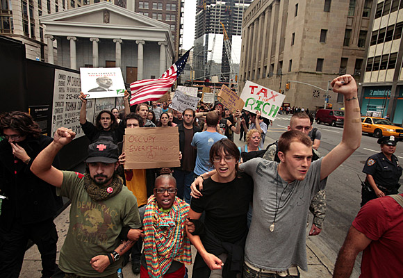 Day 13: Occupy Wall Street begins the morning with a march around the time the opening bell rings at the stock exchange.