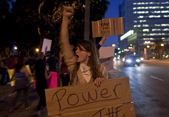 Shayne Eastin, 27, of Los Angeles protests on the second day of Occupy L.A.