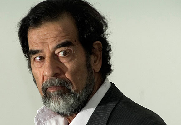 Former Iraqi President Saddam Hussein, seen           here last year, was convicted today of charges connected to the deaths of Shiite Muslim villagers.