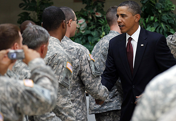 "President Obama meets with troops at Ft. Bliss, Texas. ""It's time to turn the page,"" he said."