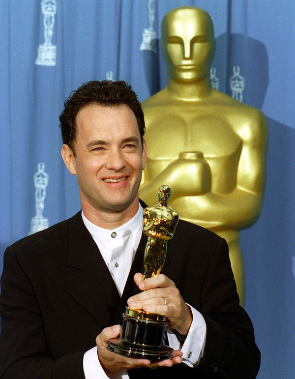 "Tom Hanks displays his Oscar for his role in ""Forrest Gump."""