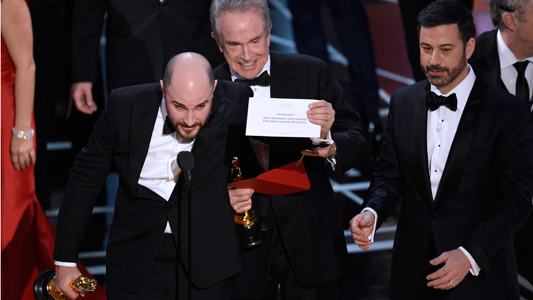 "Jordan Horowitz, producer of ""La La Land,"" shows the envelope revealing ""Moonlight"" as the true winner of best picture at the Oscars."