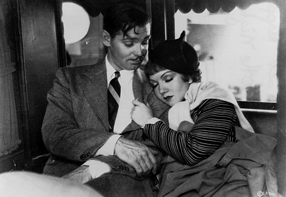 "Clark Gable and Claudette Colbert in ""It Happened One Night."""