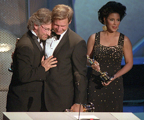"Steven Spielberg accepts the best picture Oscar from Harrison Ford for ""Schindler"