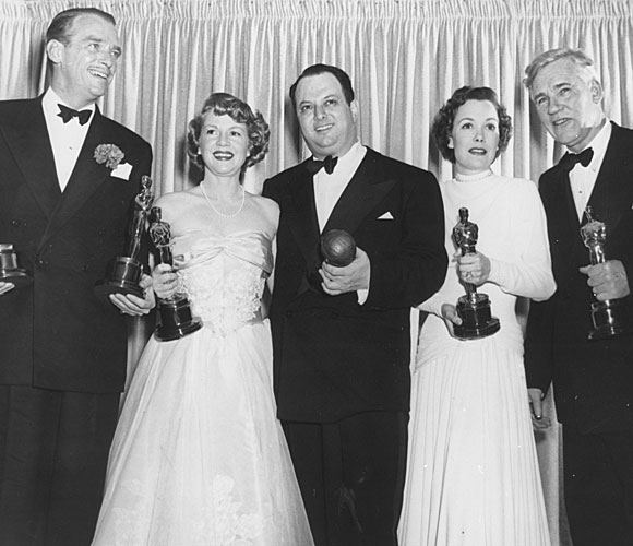 Douglas Fairbanks Jr., left, accepting for Laurence Olivier, Claire Trevor, Jerry Wald, Jane Wyman and Walter Huston.