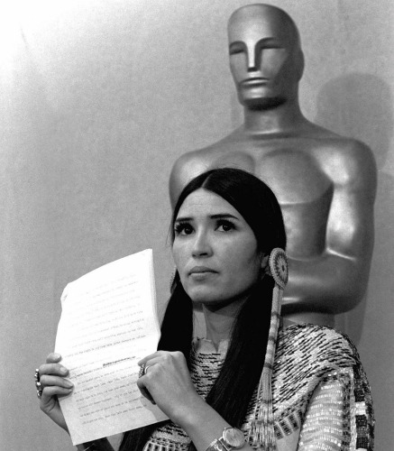Sacheen Littlefeather holds up a statement that she read to the press March 27, 1973, at the Academy Awards ceremony in Los Angeles on behalf of Marlon Brando.