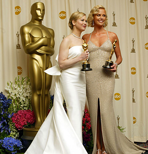 Renée Zellweger, left, and Charlize Theron pose with their Oscar statuettes.