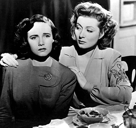 "Teresa Wright, left, and Greer Garson in a scene from ""Mrs. Miniver."""