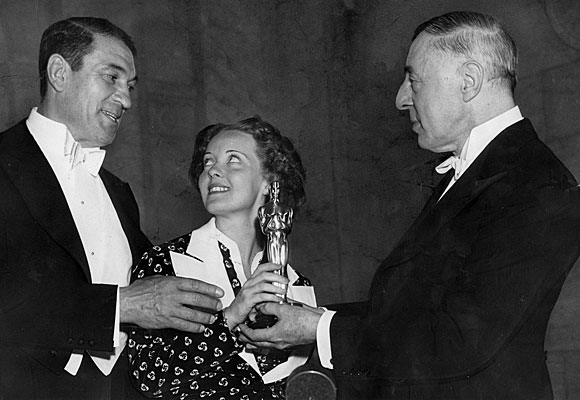 Bette Davis, center, with Victor McLaglen, left, and D.W. Griffith