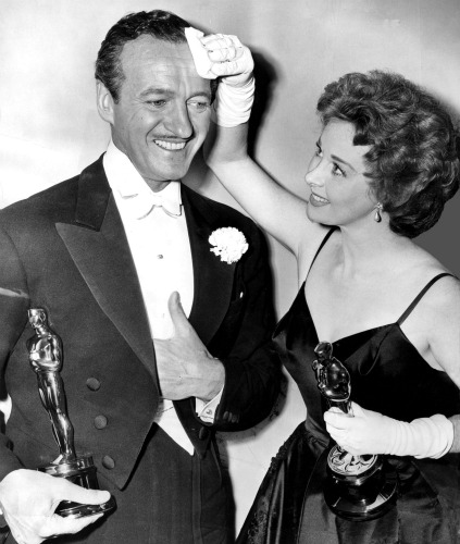 Susan Hayward wipes the brow of fellow winner David Niven.
