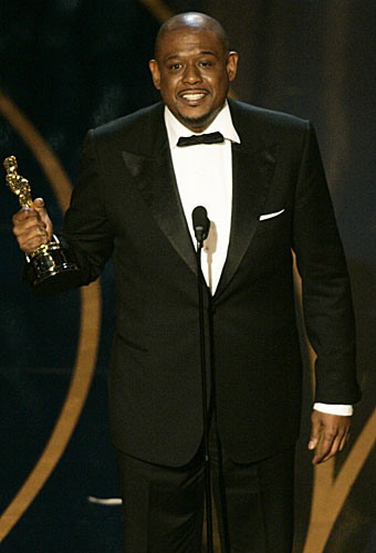 "Forest Whitaker accepts his Oscar for lead actor for his performance as Idi Amin in ""The Last King Of Scotland."""