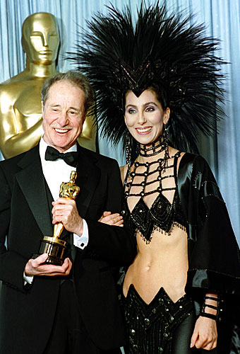 "Cher presented Don Ameche with the supporting actor Oscar for his performance in ""Cocoon."""