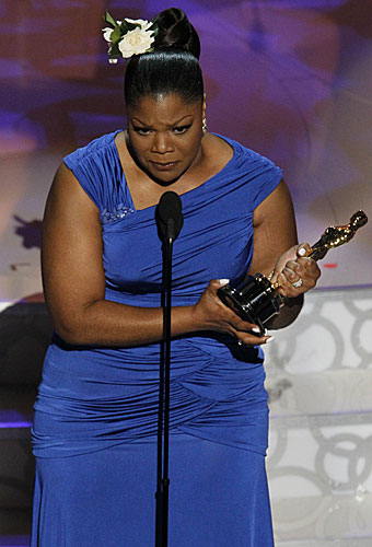 "Mo'Nique accepts her Oscar for her performance in ""Precious."""