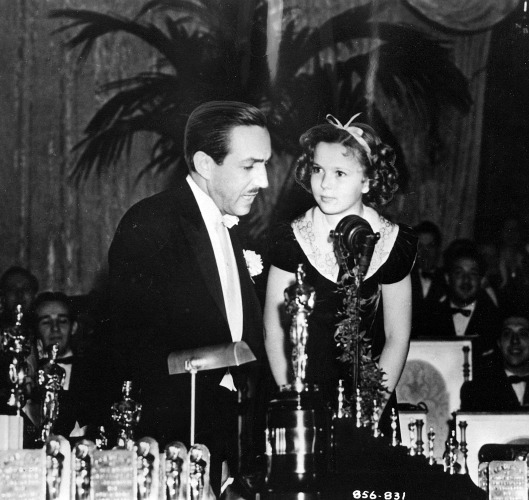 Shirley Temple, 9, presents Walt Disney with a special Oscar.