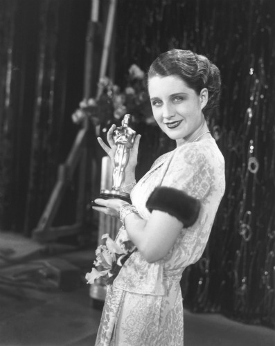 "Norma Shearer with her statuette for ""The Divorcee."""
