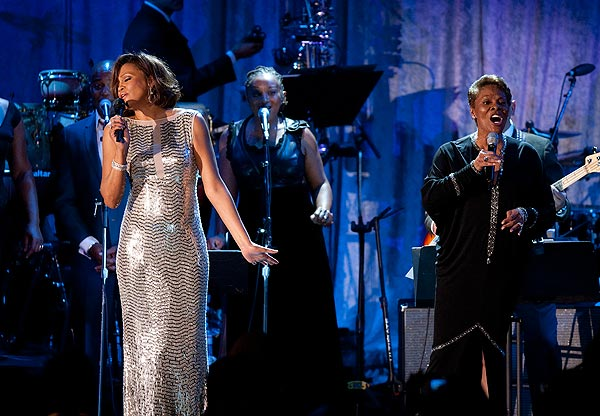 "Whitney Houston sings ""That's What Friends Are For"" with Dionne Warwick at Clive Davis' pre-Grammy party in 2011."