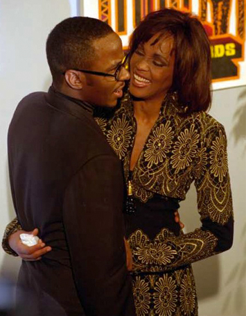 Whitney Houston and Bobby Brown pose for the cameras after the 1994 Soul Train Music Awards.