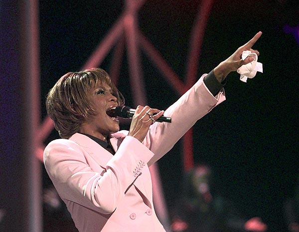 "Whitney Houston performs ""Until You Come Back to Me"" during the 1999 American Music Awards at the Shrine Auditorium in Los Angeles."