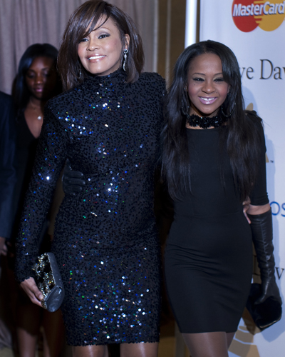 Whitney Houston attends the Clive Davis pre-Grammy party with Bobbi Kristina Brown in 2011.