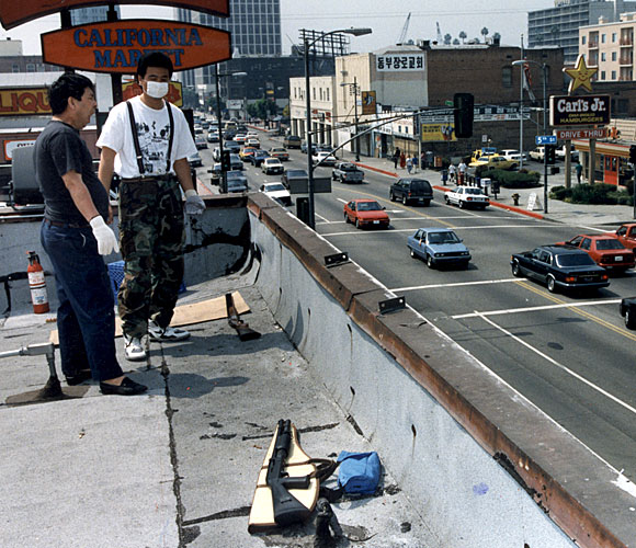 Employees of California Market in Koreatown guard the store from the rooftop. (May 1, 1992)