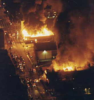 Aerial view of fires burning out of control in the vicinity of Vermont and Vernon avenues. (April 29, 1992)