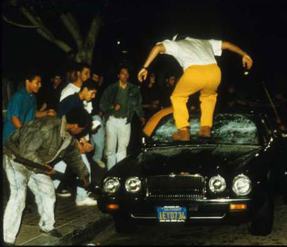 Protesters kick in the windshield of a Jaguar parked on Main Street across from City Hall. (April 29, 1992)