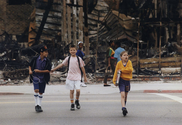 Students cross the street on their way to classes at the Budlong Avenue Elementary School. (May 4, 1992)