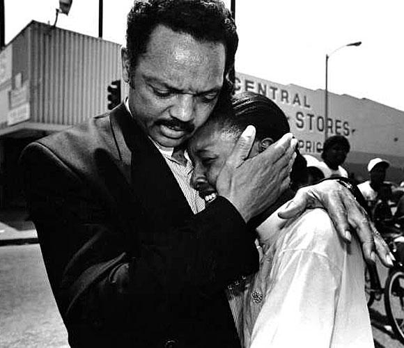 Jesse Jackson comforts Charlotte McKoy. (May 2, 1992)