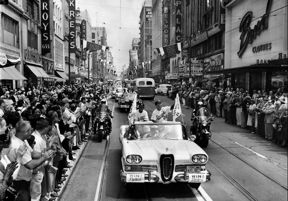 April 18, 1958: Spectators line Broadway as Dodgers Manager Walter Alston, right, and coach Charlie Dressen