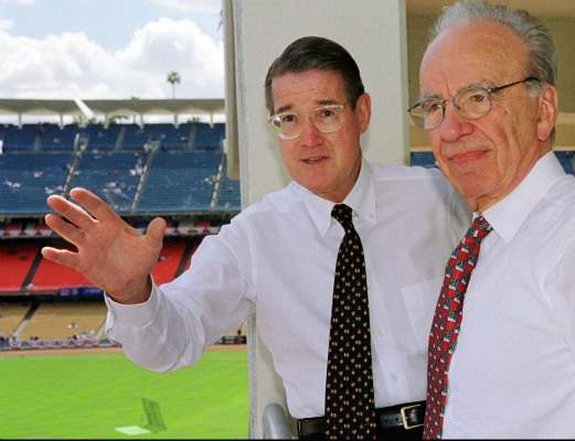 Former Los Angeles Dodgers owner Peter O'Malley, left, and new owner Rupert Murdoch look over the playing field during Opening Day in 1998.