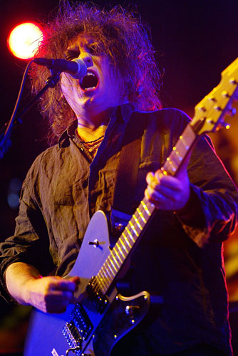 Robert Smith of the Cure sings at Coachella on May 2, 2004.