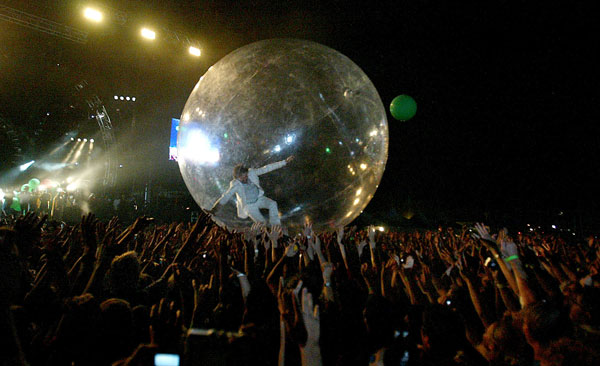 Wayne Coyne of the Flaming Lips rolls over the crowd.