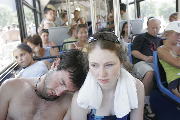 Fans cool off in a bus at Lollapalooza in Chicago.